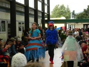 On the left is the Calf Club Wearable Arts contest winner with a dress woven out of recycled plastic something...